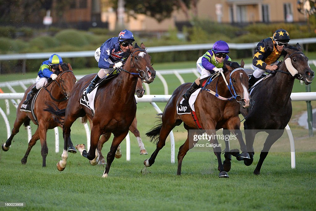 Glen Boss riding Shamexpress (L) races to win the Chadler Macleod Premium Handicap from Jackie Beriman riding Day Procedure (Ctr) during Melbourne racing at Moonee Valley Racecourse on January 25, 2013 in Melbourne, Australia.
