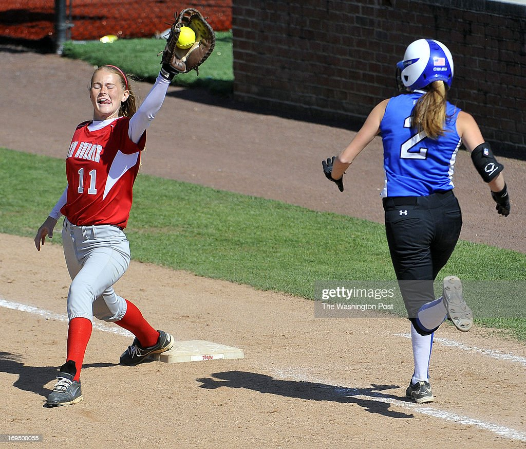 Glen Burnie's Megan Diggs makes the catch and play at first base on Sherwood's Meggie Dejter in the Maryland 4A softball championship game at the University of Maryland's Robert E. Taylor Stadium on May, 25, 2013 in College Park, Md.