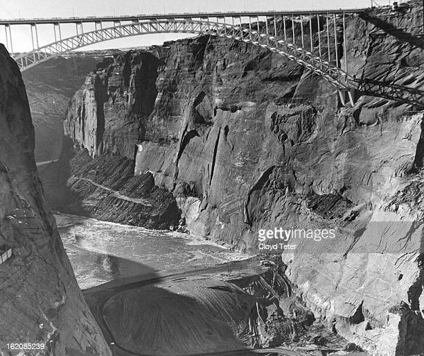 JAN 9 1960 JAN 10 1960 Glen Canyon Dam Reservoir 1960 This view looks downstream under the $5 million Glen Canyon Bridge world's largest steel arch...