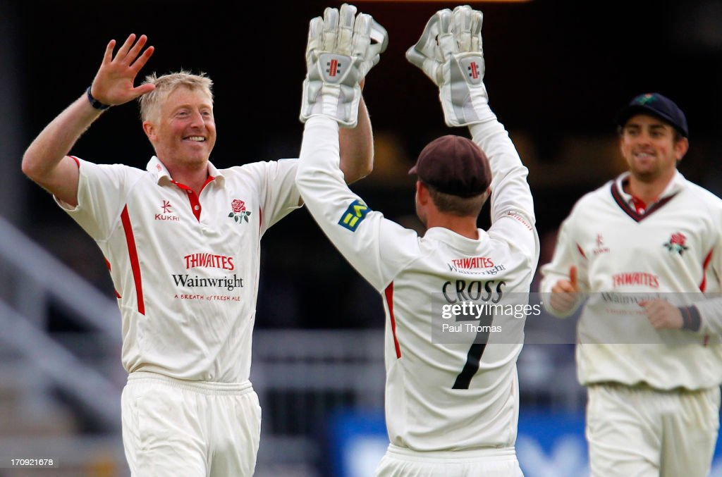 Glen Chapple (L) of Lancashire celebrates the wicket of Northants batsman James Middlebrook with teammate Gareth Cross during day one of the LV County Championship Division Two match between Lancashire and Northamptonshire at Old Trafford on June 20, 2013 in Manchester, England.