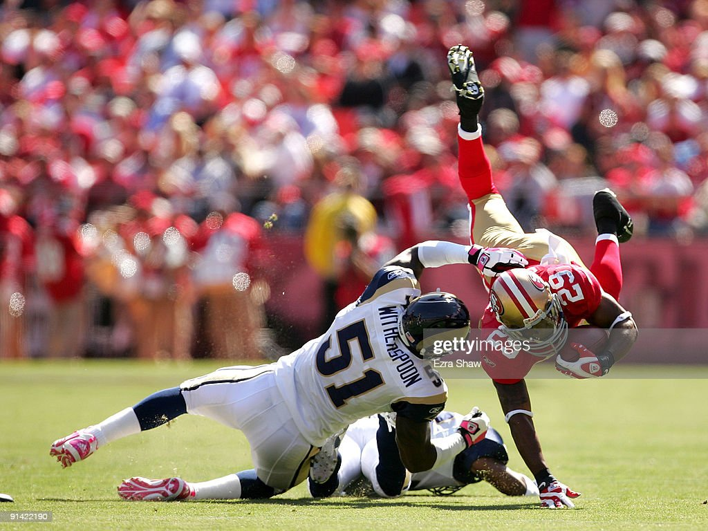 73c38291247 ... Glen Coffee 29 of the San Francisco 49ers is tackled by Will  Witherspoon 51 ...