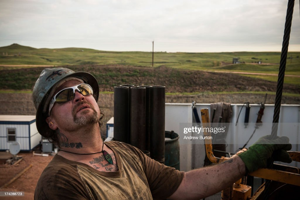 Glen Crabtree, a floor hand for Raven Drilling, lines up a pipe while drilling for oil in the Bakken shale formation on July 23, 2013 outside Watford City, North Dakota. North Dakota is been experiencing an oil boom in recent years, due in part to new drilling techniques including hydraulic fracturing and horizontal drilling. In April 2013, The United States Geological Survey released a new study estimating the Bakken formation and surrounding oil fields could yield up to 7.4 billion barrels of oil, doubling their estimate of 2008, which was estimated at 3.65 billion barrels of oil.