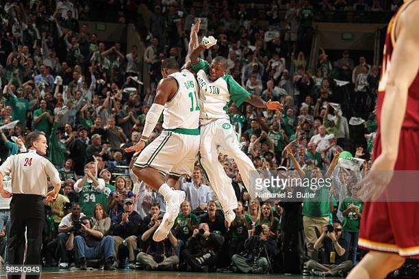 Glen Davis and Nate Robinson of the Boston Celtics celebrate a big basket by Davis while playing against the Cleveland Cavaliers in Game Four of the...