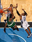 Glen Davis of the Boston Celtics dunks against Dwight Howard and Rashard Lewis of the Orlando Magic in Game Two of the Eastern Conference Finals...
