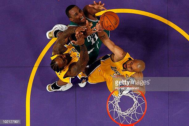 Glen Davis of the Boston Celtics goes up for a rebound between Josh Powell and Derek Fisher of the Los Angeles Lakers in Game Six of the 2010 NBA...