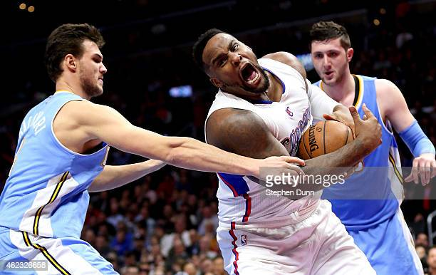 Glen Davis of the Los Angeles Clippers controls a loose ball against Danilo Gallinari of the Denver Nuggets at Staples Center on January 26 2015 in...