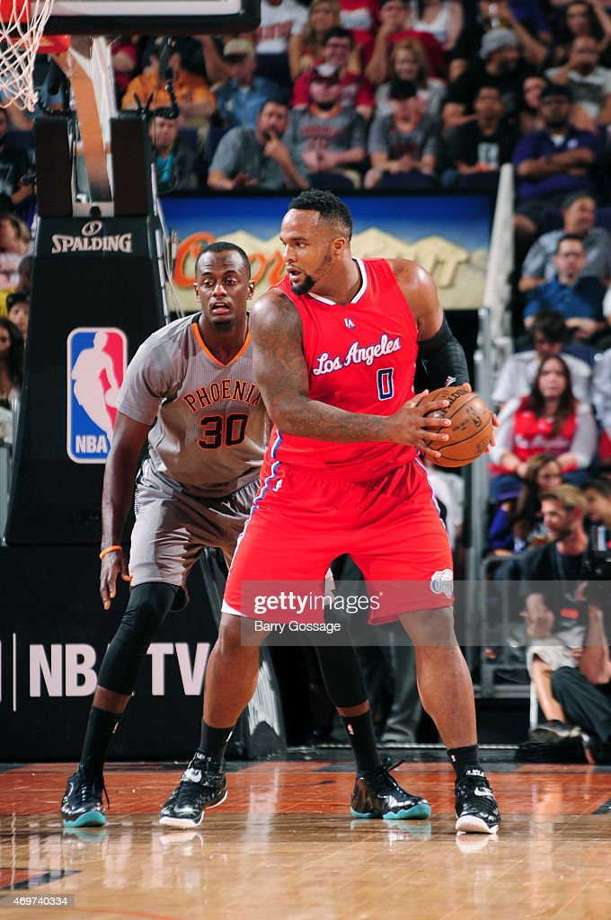 <a gi-track='captionPersonalityLinkClicked' href=/galleries/search?phrase=Glen+Davis+-+Basketball+Player&family=editorial&specificpeople=709385 ng-click='$event.stopPropagation()'>Glen Davis</a> #0 of the Los Angeles Clippers is guarded by <a gi-track='captionPersonalityLinkClicked' href=/galleries/search?phrase=Earl+Barron&family=editorial&specificpeople=234747 ng-click='$event.stopPropagation()'>Earl Barron</a> #30 of the Phoenix Suns on April 14, 2015 at U.S. Airways Center in Phoenix, Arizona.