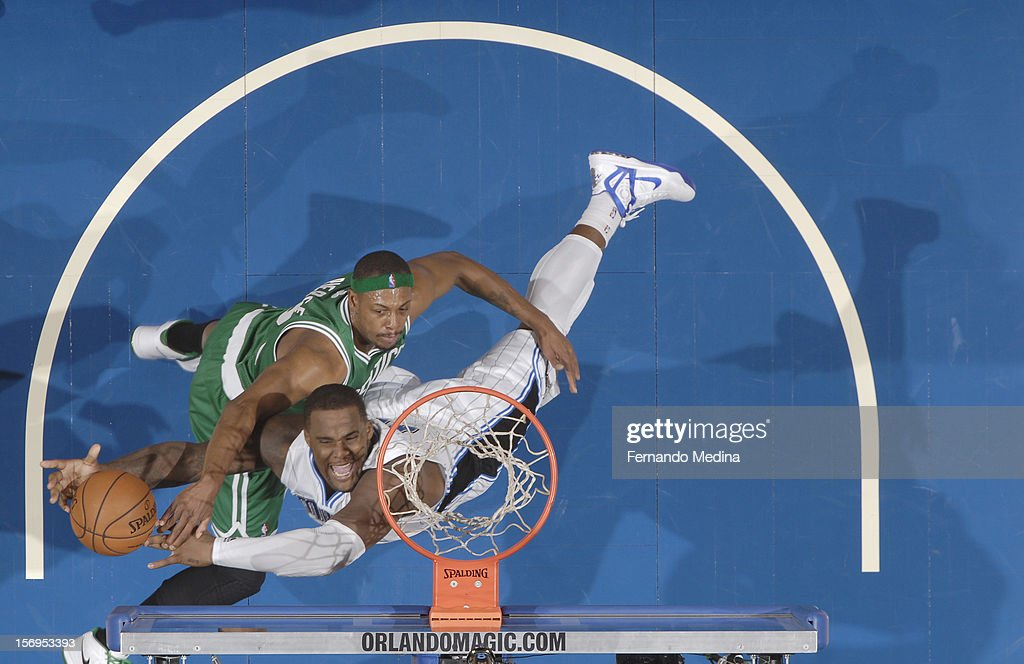 Glen Davis #11 of the Orlando Magic battles for the ball control with Paul Pierce #34 of the Boston Celtics during the game between the Boston Celtics and the Orlando Magic on November 25, 2012 at Amway Center in Orlando, Florida.