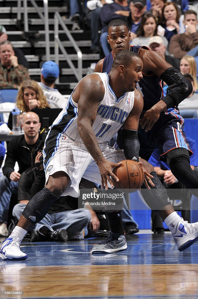 Glen Davis #11 of the Orlando Magic drives against Jeff Adrien #4 of the Charlotte Bobcats on January 18, 2013 at Amway Center in Orlando, Florida.