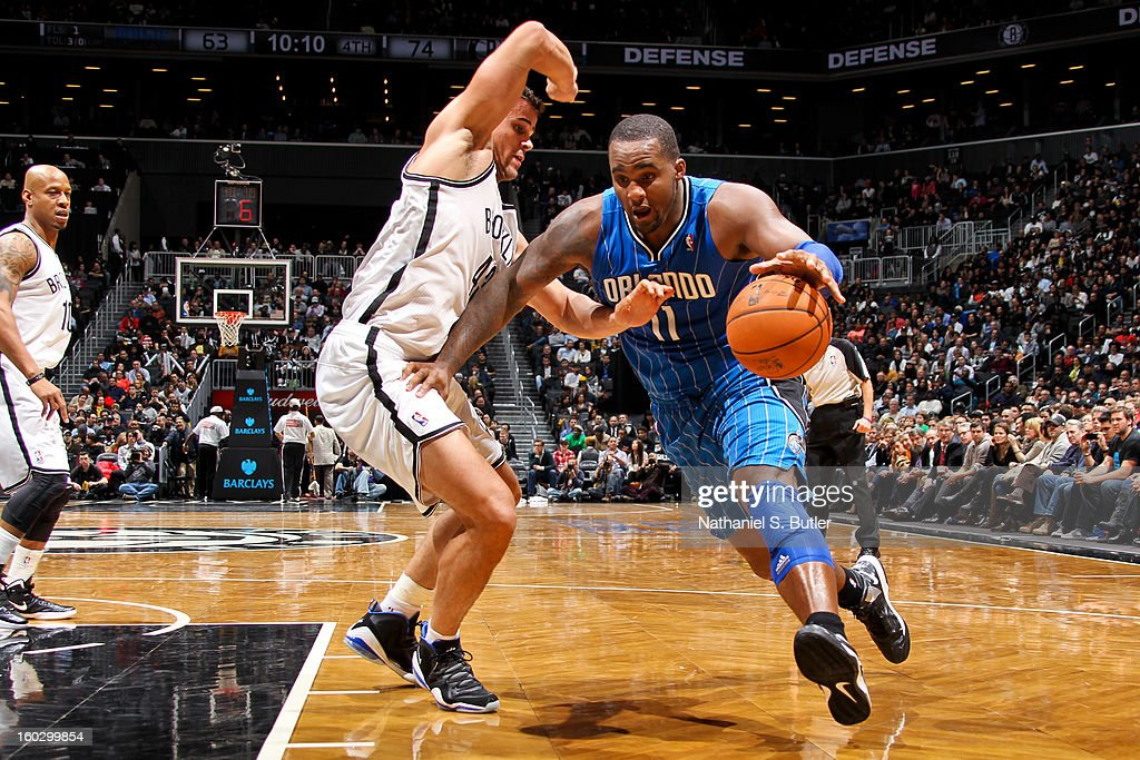 Glen Davis #11 of the Orlando Magic drives against Kris Humphries #43 of the Brooklyn Nets on January 28, 2013 at the Barclays Center in the Brooklyn borough of New York City.