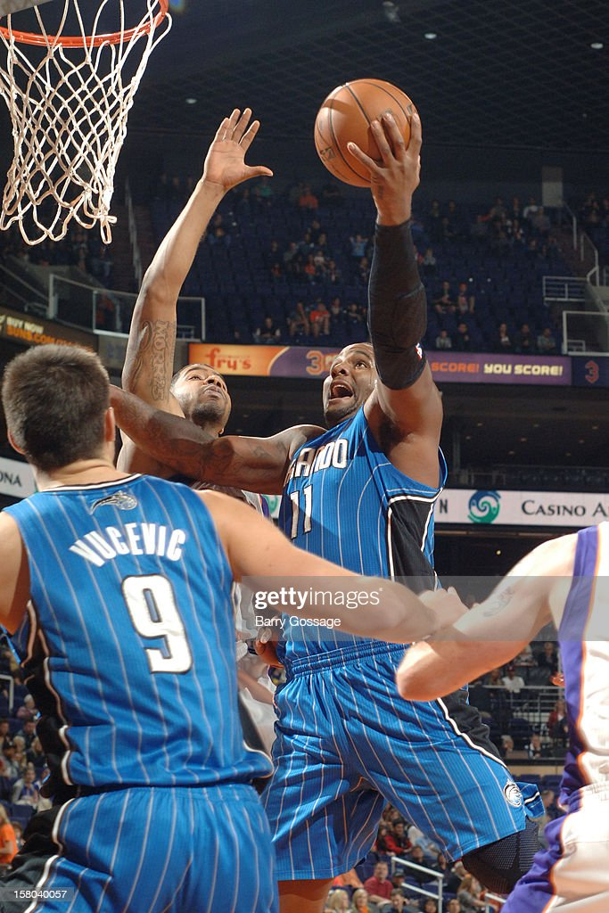 Glen Davis #11 of the Orlando Magic drives for a shot against Markieff Morris #11 of the Phoenix Suns on December 9, 2012 at U.S. Airways Center in Phoenix, Arizona.