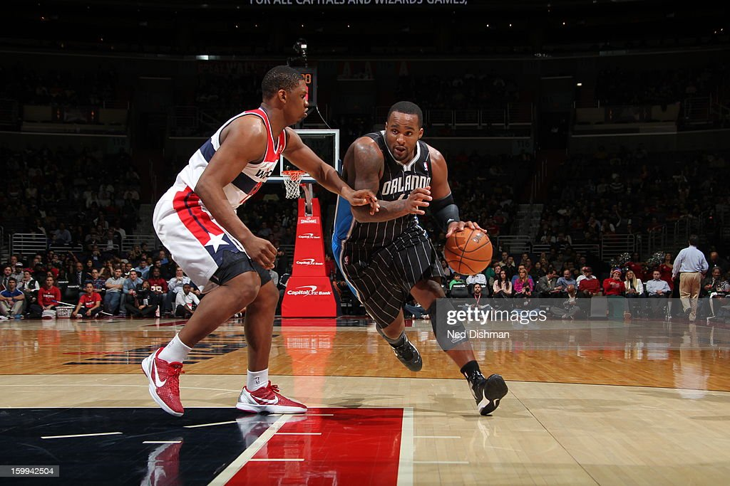<a gi-track='captionPersonalityLinkClicked' href=/galleries/search?phrase=Glen+Davis+-+Basketball+Player&family=editorial&specificpeople=709385 ng-click='$event.stopPropagation()'>Glen Davis</a> #11 of the Orlando Magic drives to the basket against <a gi-track='captionPersonalityLinkClicked' href=/galleries/search?phrase=Kevin+Seraphin&family=editorial&specificpeople=6474998 ng-click='$event.stopPropagation()'>Kevin Seraphin</a> #13 of the Washington Wizards during the game at the Verizon Center on January 14, 2013 in Washington, DC.