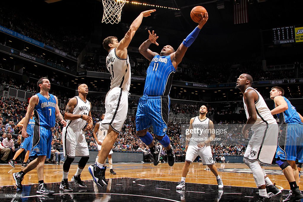 Glen Davis #11 of the Orlando Magic drives to the basket against Kris Humphries #43 of the Brooklyn Nets on January 28, 2013 at the Barclays Center in the Brooklyn borough of New York City.