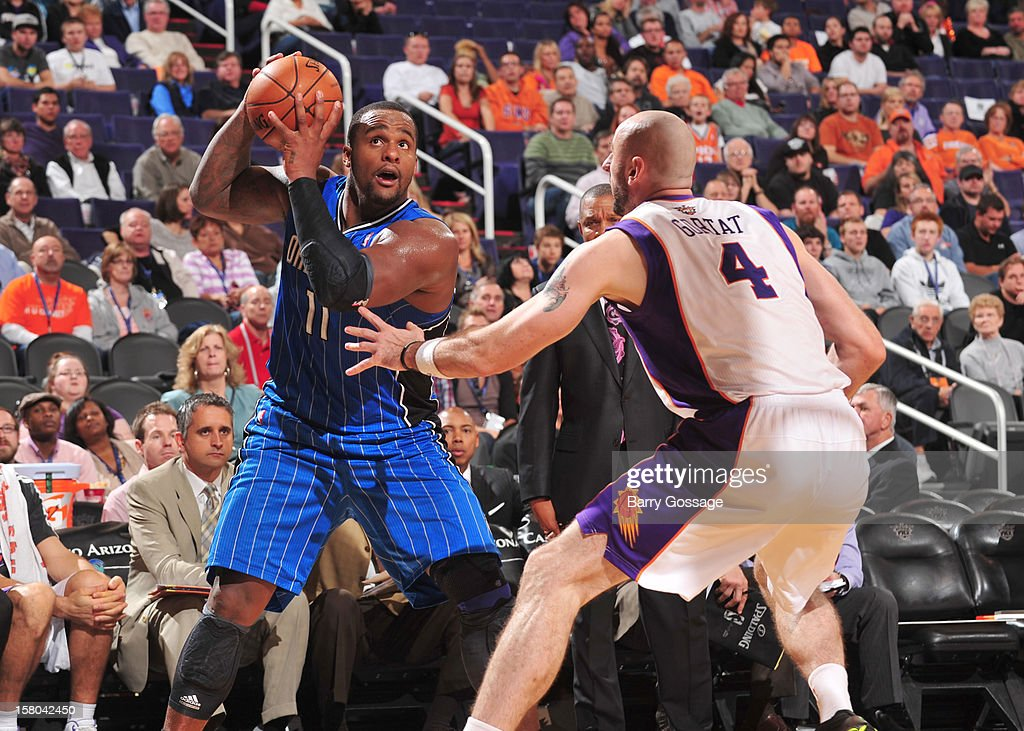 Glen Davis #11 of the Orlando Magic eyes the clock as Marcin Gortat #4 of the Phoenix Suns defends on December 9, 2012 at U.S. Airways Center in Phoenix, Arizona.