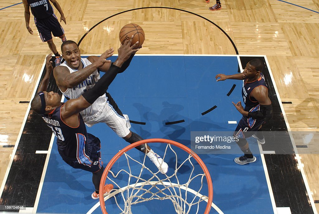 Glen Davis #11 of the Orlando Magic goes to the basket against Brendan Haywood #33 of the Charlotte Bobcats on January 18, 2013 at Amway Center in Orlando, Florida.