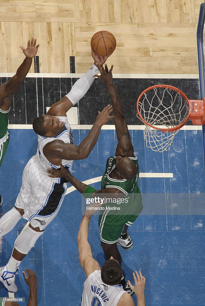Glen Davis #11 of the Orlando Magic goes to the basket against defense during the game between the Boston Celtics and the Orlando Magic on November 25, 2012 at Amway Center in Orlando, Florida.
