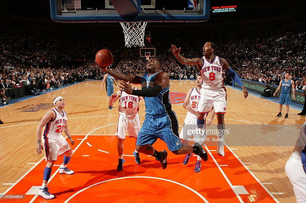 <a gi-track='captionPersonalityLinkClicked' href=/galleries/search?phrase=Glen+Davis+-+Basketball+Player&family=editorial&specificpeople=709385 ng-click='$event.stopPropagation()'>Glen Davis</a> #11 of the Orlando Magic goes to the basket against <a gi-track='captionPersonalityLinkClicked' href=/galleries/search?phrase=J.R.+Smith&family=editorial&specificpeople=201766 ng-click='$event.stopPropagation()'>J.R. Smith</a> #8 of the New York Knicks during the game on March 28, 2012 at Madison Square Garden in New York City.