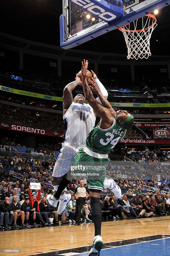 Glen Davis #11 of the Orlando Magic goes to the basket against Paul Pierce #34 of the Boston Celtics during the game between the Boston Celtics and the Orlando Magic on November 25, 2012 at Amway Center in Orlando, Florida.