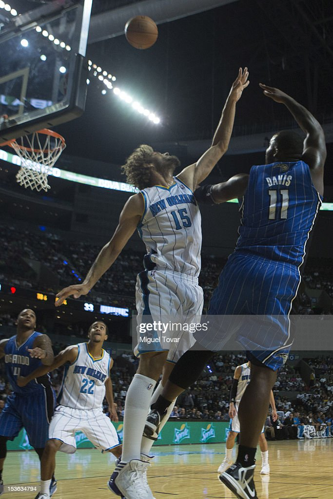 Glen Davis #11 of the Orlando Magic goes to the basket against Robin Lopez #11 of the New Orleans Hornets during the game between the Orlando Magic and the New Orleans Hornets on October 7, 2012 at Mexico City Arena in Mexico City.