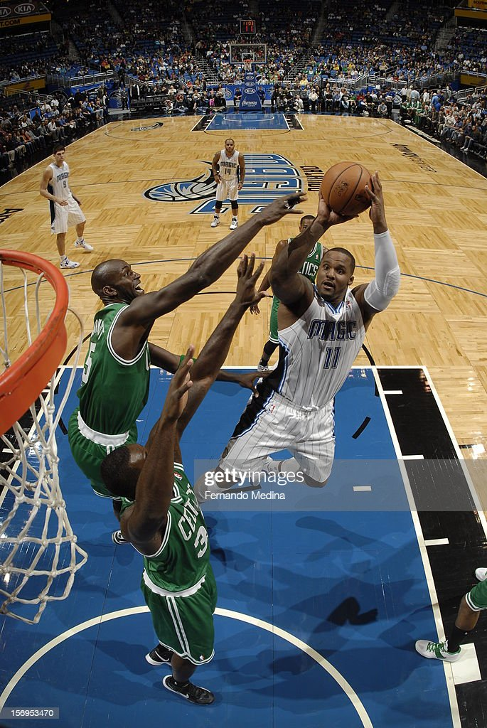 <a gi-track='captionPersonalityLinkClicked' href=/galleries/search?phrase=Glen+Davis+-+Basketballer&family=editorial&specificpeople=709385 ng-click='$event.stopPropagation()'>Glen Davis</a> #11 of the Orlando Magic goes to the basket during the game between the Boston Celtics and the Orlando Magic on November 25, 2012 at Amway Center in Orlando, Florida.