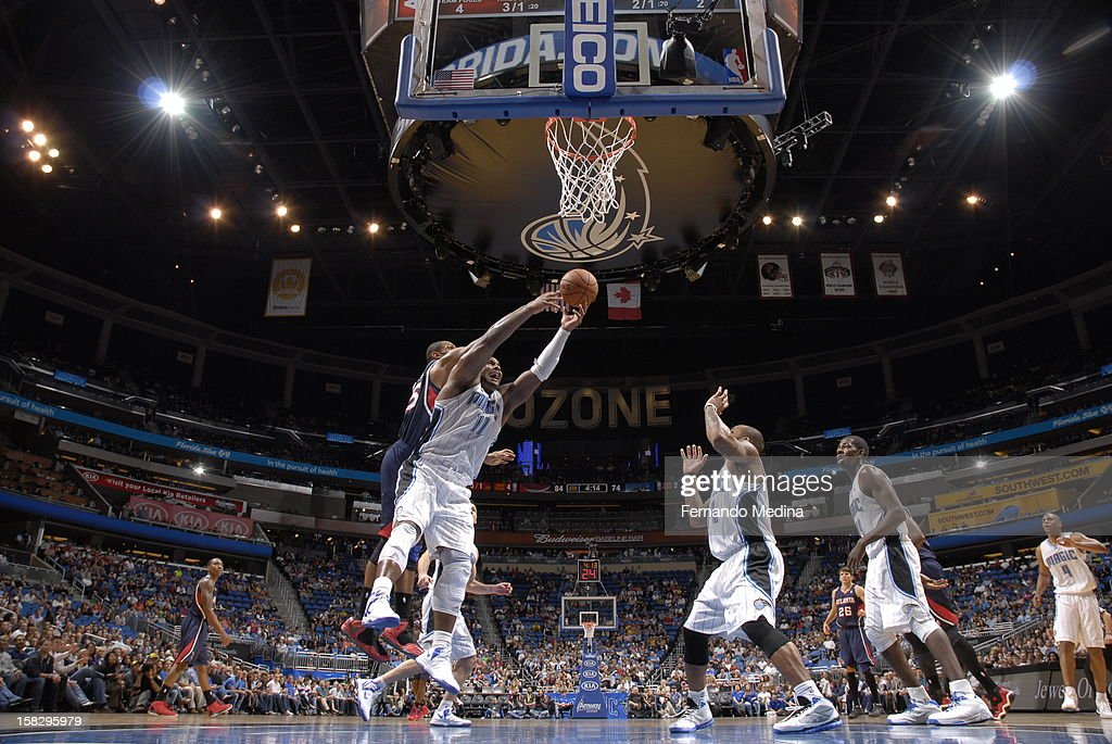 Glen Davis #11 of the Orlando Magic grabs a rebound against the Atlanta Hawks during the game on December 12, 2012 at Amway Center in Orlando, Florida.
