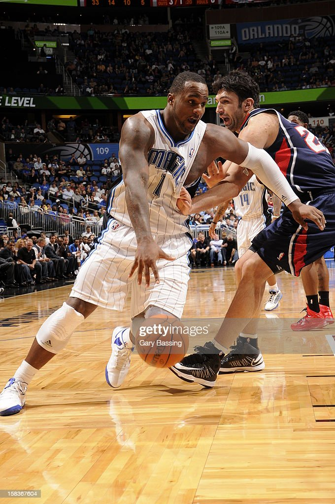 Glen Davis #11 of the Orlando Magic handles the ball against Zaza Pachulia #27 of the Atlanta Hawks on December 12, 2012 at Amway Center in Orlando, Florida.