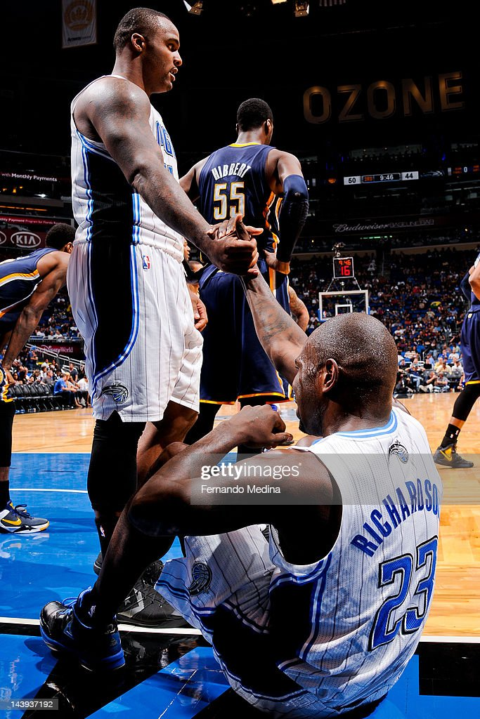 <a gi-track='captionPersonalityLinkClicked' href=/galleries/search?phrase=Glen+Davis+-+Basketball+Player&family=editorial&specificpeople=709385 ng-click='$event.stopPropagation()'>Glen Davis</a> #11 of the Orlando Magic helps up teammate <a gi-track='captionPersonalityLinkClicked' href=/galleries/search?phrase=Jason+Richardson+-+Basketball+Player+-+Born+1981&family=editorial&specificpeople=201558 ng-click='$event.stopPropagation()'>Jason Richardson</a> #23 against the Indiana Pacers in Game Four of the Eastern Conference Quarterfinals during the 2012 NBA Playoffs on May 5, 2012 at Amway Center in Orlando, Florida.