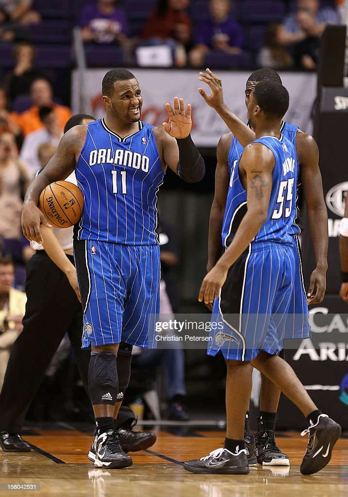 <a gi-track='captionPersonalityLinkClicked' href=/galleries/search?phrase=Glen+Davis+-+Basketballer&family=editorial&specificpeople=709385 ng-click='$event.stopPropagation()'>Glen Davis</a> #11 of the Orlando Magic high-fives teammates after scoring against the Phoenix Suns during the NBA game at US Airways Center on December 9, 2012 in Phoenix, Arizona. The Magic defeated the Suns 98-90.