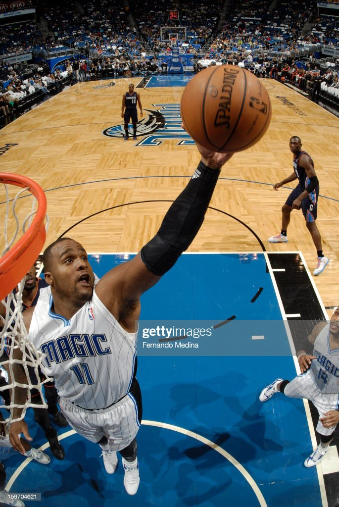Glen Davis #11 of the Orlando Magic rebounds against the Charlotte Bobcats on January 18, 2013 at Amway Center in Orlando, Florida.
