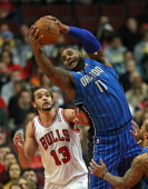 Glen Davis of the Orlando Magic rebounds over Joakim Noah of the Chicago Bulls at the United Center on December 16 2013 in Chicago Illinois NOTE TO...