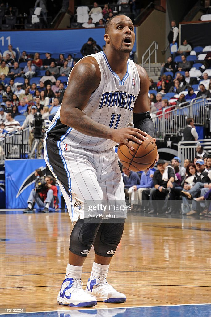 <a gi-track='captionPersonalityLinkClicked' href=/galleries/search?phrase=Glen+Davis+-+Basketballer&family=editorial&specificpeople=709385 ng-click='$event.stopPropagation()'>Glen Davis</a> #11 of the Orlando Magic shoots a free throw during a game against the Charlotte Bobcats on January 18, 2013 at Amway Center in Orlando, Florida.