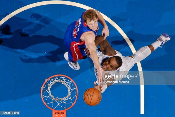 Glen Davis of the Orlando Magic shoots a layup against Kyle Singler of the Detroit Pistons on November 21 2012 at Amway Center in Orlando Florida...