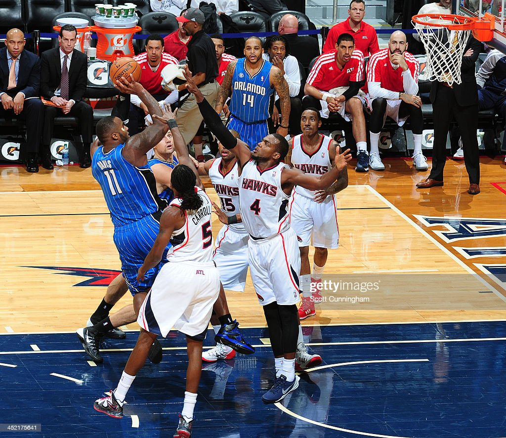 Glen Davis #11 of the Orlando Magic shoots against <a gi-track='captionPersonalityLinkClicked' href=/galleries/search?phrase=Paul+Millsap&family=editorial&specificpeople=880017 ng-click='$event.stopPropagation()'>Paul Millsap</a> #4 of the Atlanta Hawks on November 26, 2013 at Philips Arena in Atlanta, Georgia.