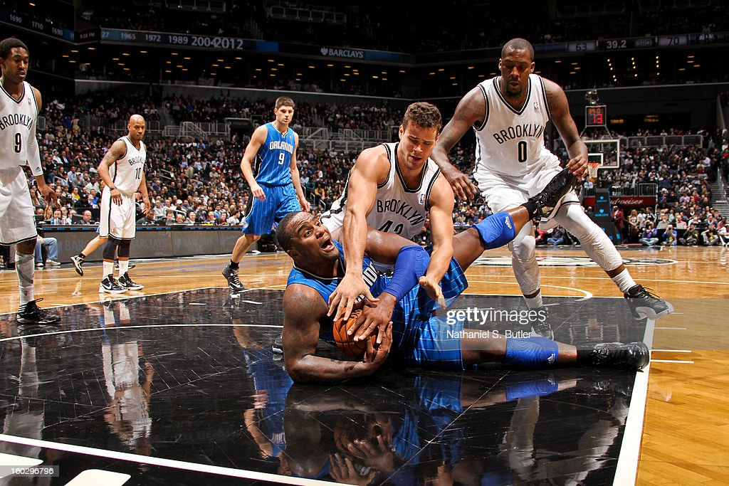 Glen Davis #11 of the Orlando Magic tries to control a loose ball against Kris Humphries #43 of the Brooklyn Nets on January 28, 2013 at the Barclays Center in the Brooklyn borough of New York City.