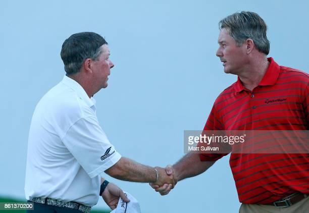 Glen Day shakes hands with Todd Hamilton on the 18th hole after their second round of the SAS Championship at Prestonwood Country Club on October 14...