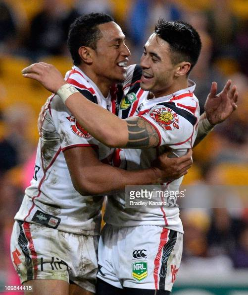 Glen Fisiiahi of the Warriors celebrates with Shaun Johnson after scoring a try during the round 12 NRL match between the Brisbane Broncos and the...