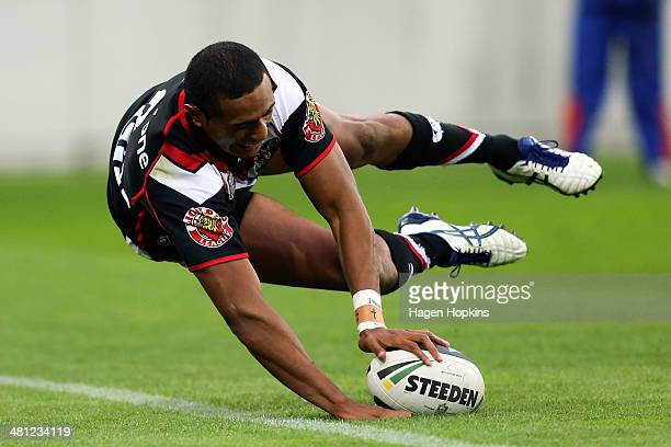 Glen Fisiiahi of the Warriors scores his third try of the game during the round four NRL match between the New Zealand Warriors and the Wests Tigers...