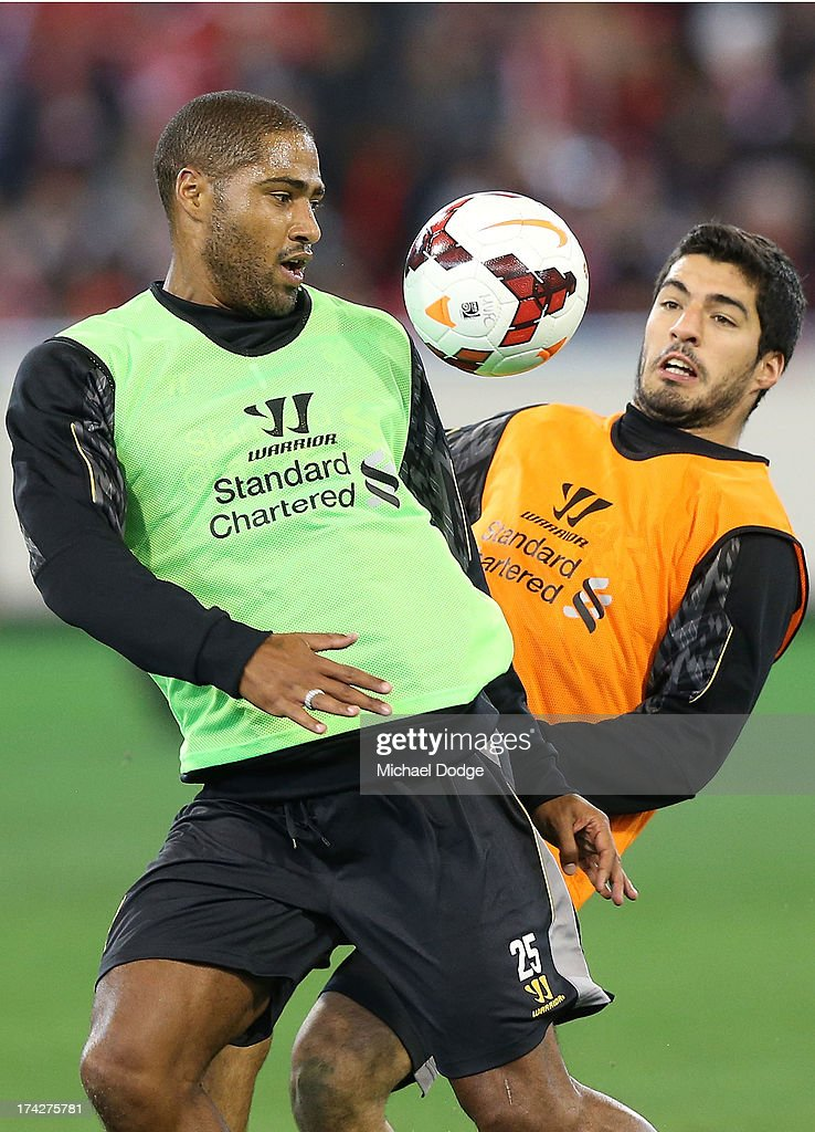 <a gi-track='captionPersonalityLinkClicked' href=/galleries/search?phrase=Glen+Johnson&family=editorial&specificpeople=209192 ng-click='$event.stopPropagation()'>Glen Johnson</a> (L) and Luis Suarez contest for the ball during a Liverpool FC training session at Melbourne Cricket Ground on July 23, 2013 in Melbourne, Australia.