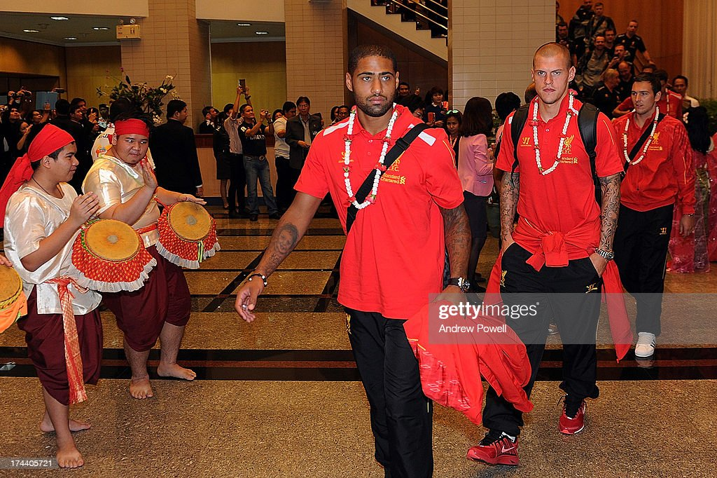 <a gi-track='captionPersonalityLinkClicked' href=/galleries/search?phrase=Glen+Johnson&family=editorial&specificpeople=209192 ng-click='$event.stopPropagation()'>Glen Johnson</a> and <a gi-track='captionPersonalityLinkClicked' href=/galleries/search?phrase=Martin+Skrtel&family=editorial&specificpeople=5554576 ng-click='$event.stopPropagation()'>Martin Skrtel</a> of Liverpool arrives in Bangkok for a stop on the club's Pre-Season tour on July 25, 2013 in Bangkok, Thailand.