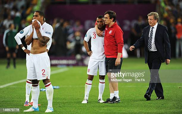 Glen Johnson Ashley Cole Gary Neville and manager Roy Hodgson look dejected after the penalty shoot out during the UEFA EURO 2012 quarter final match...
