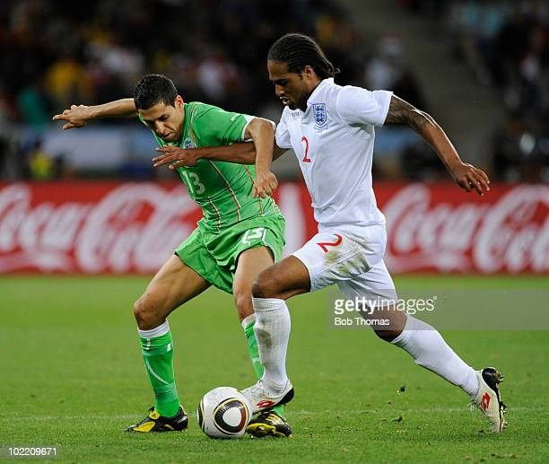 Glen Johnson of England challenged by Karim Matmour of Algeria during the 2010 FIFA World Cup South Africa Group C match between England and Algeria...