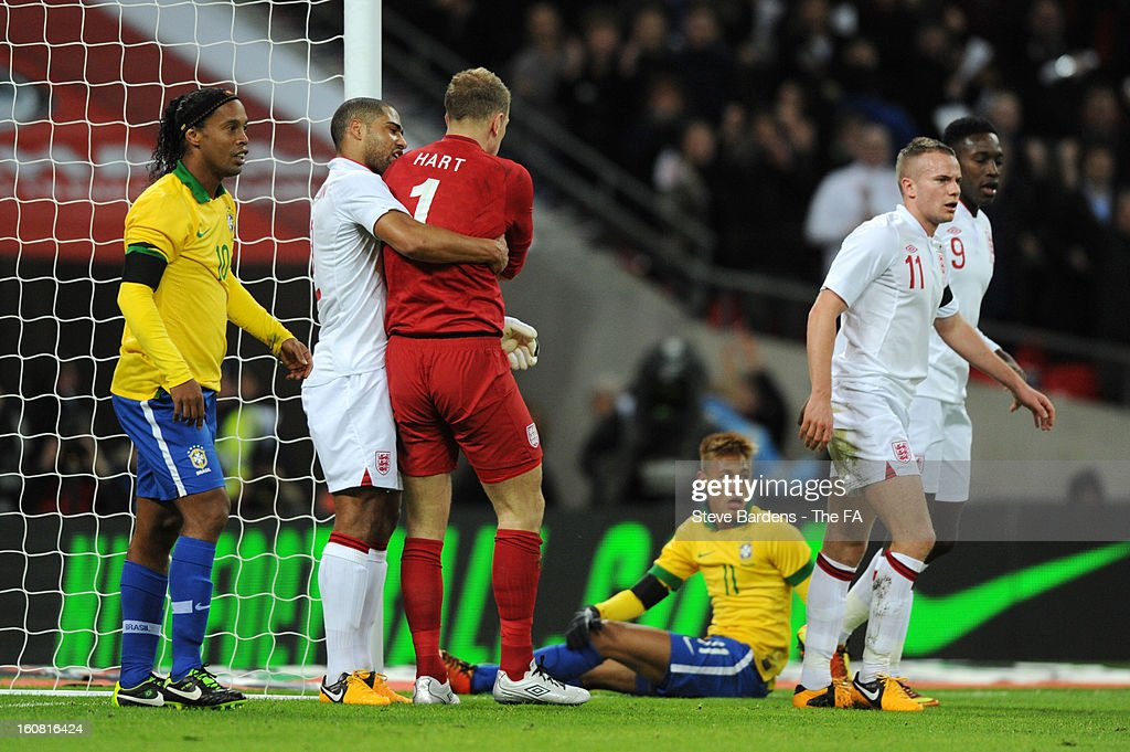 Glen Johnson of England congratulates goalkeeper Joe Hart after he saved the penalty of Ronaldinho of Brazil during the International Friendly match between England and Brazil at Wembley Stadium on February 6, 2013 in London, England.