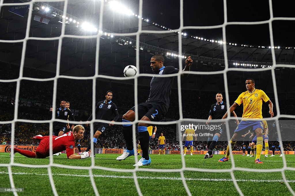 <a gi-track='captionPersonalityLinkClicked' href=/galleries/search?phrase=Glen+Johnson&family=editorial&specificpeople=209192 ng-click='$event.stopPropagation()'>Glen Johnson</a> of England scores an own goal off of Olof Mellberg of Sweden effort during the UEFA EURO 2012 group D match between Sweden and England at The Olympic Stadium on June 15, 2012 in Kiev, Ukraine.