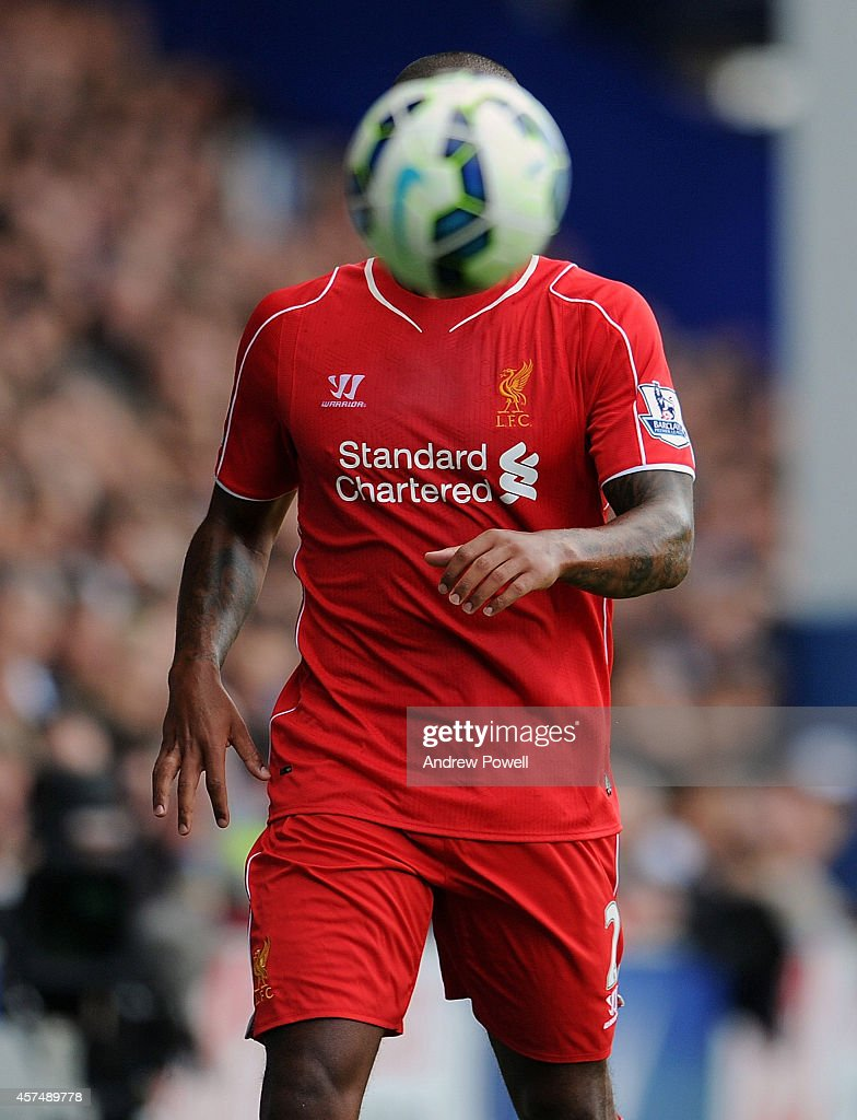 Glen Johnson of Liveprool hidden by a Premier League match ball during the Barclays Premier Leauge match between Queens Park Rangers and Liverpool at Loftus Road on October 19, 2014 in London, England.