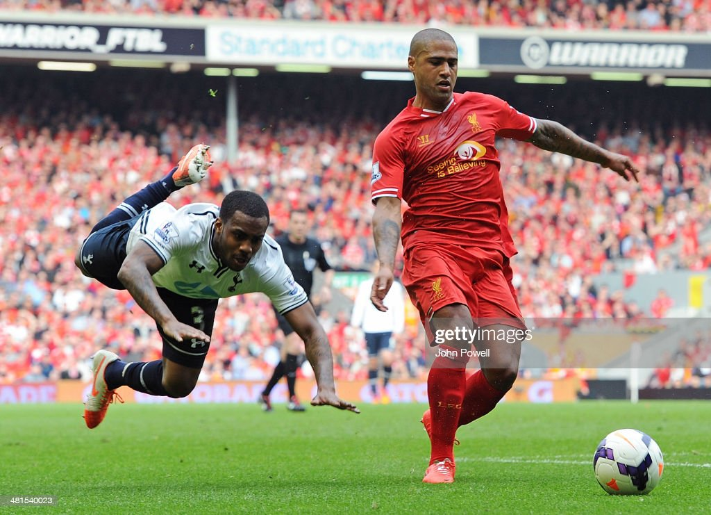 Glen Johnson of Liverpool and Danny Rose of Tottenham Hotspur compete during the Barclays Premier League match between Liverpool and Tottenham Hotspur at Anfield on March 30, 2014 in Liverpool, England.