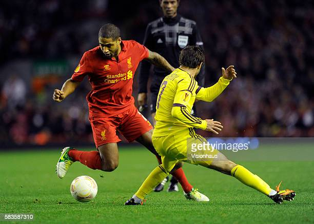 Glen Johnson of Liverpool and Kamil Agalarov of FC Anji Makhachkala in action during the UEFA Europa League Group A match between Liverpool and FC...