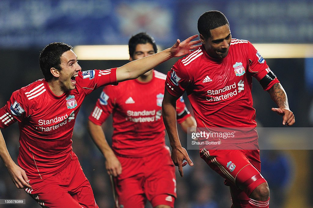 <a gi-track='captionPersonalityLinkClicked' href=/galleries/search?phrase=Glen+Johnson&family=editorial&specificpeople=209192 ng-click='$event.stopPropagation()'>Glen Johnson</a> (R) of Liverpool celebrates his goal with <a gi-track='captionPersonalityLinkClicked' href=/galleries/search?phrase=Stewart+Downing&family=editorial&specificpeople=238961 ng-click='$event.stopPropagation()'>Stewart Downing</a> during the Barclays Premier League match between Chelsea and Liverpool at Stamford Bridge on November 20, 2011 in London, England.