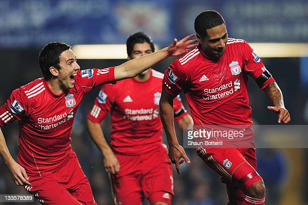 Glen Johnson of Liverpool celebrates his goal with Stewart Downing during the Barclays Premier League match between Chelsea and Liverpool at Stamford...