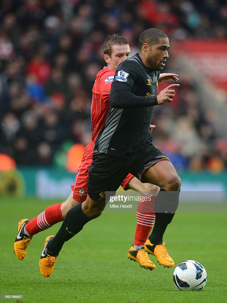 Glen Johnson of Liverpool runs with the ball during the Barclays Premier League match between Southampton and Liverpool at St Mary's Stadium on March 16, 2013 in Southampton, England.