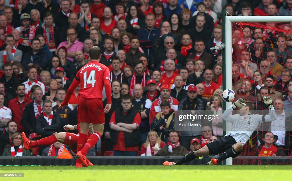 Glen Johnson of Liverpool (not pictured) scores an own goal during the Barclays Premier League match between Liverpool and Manchester City at Anfield on April 13, 2014 in Liverpool, England.